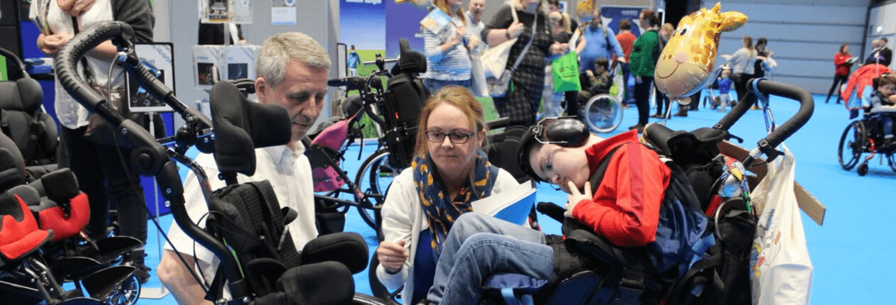 boy with mum viewing disability equipment