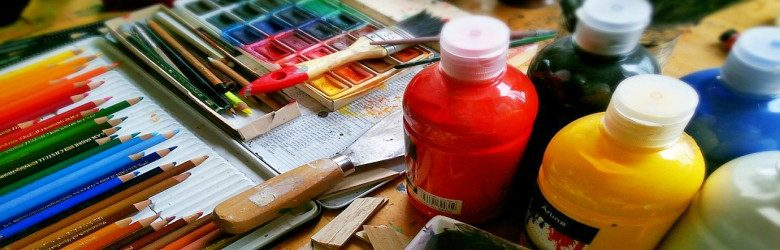 bottles of paints, water colours and paint palette