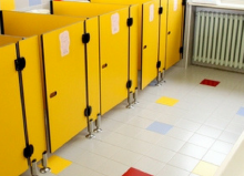 school toilet cubicles with yellow doors