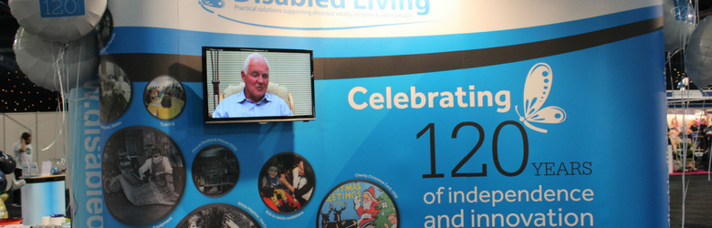 disabled living 120 years stand with tv screen at kidz to adultz north