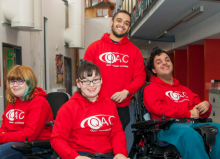children and young people in qac hoodies