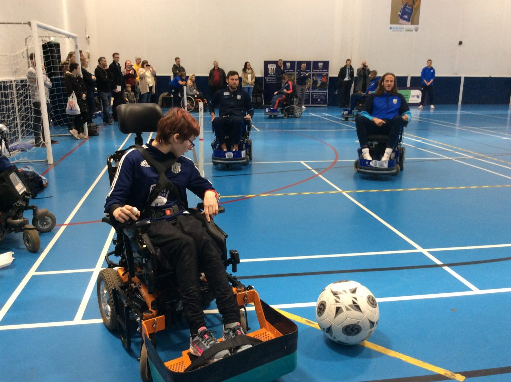QAC Powerchair football student