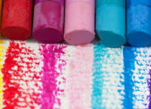 a row of oil pastels in different colours