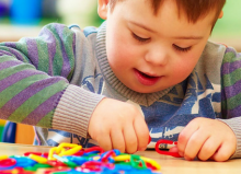 cerebral palsy young boy playing with puzzle