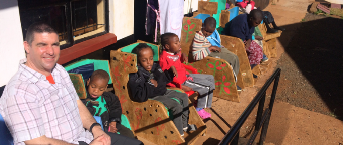 children in chairs in kenya