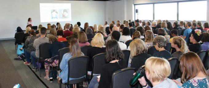 kidz south seminar room full of people