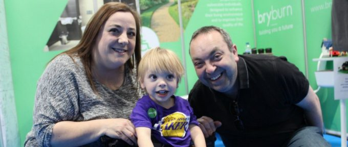aiden with his mum and dad at kidz to adultz exhibition