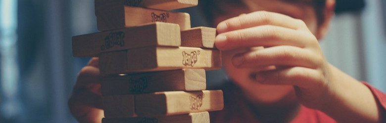little boy playing jenga