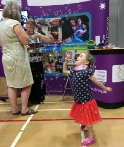 carmela blowing bubbles at kidz exhibition