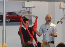demonstrating safe hoisting of disabled children