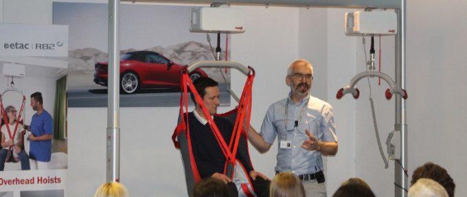 demonstrating safe hoisting of disabled children