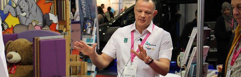 ot shaun masters talking to exhibitors