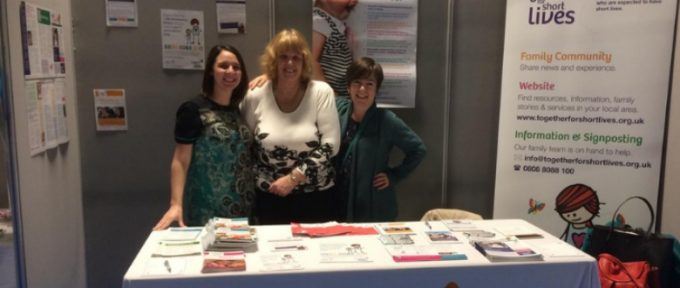 together for short lives representatives stood at their exhibition stand