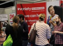people at variety's stand an the exhibition