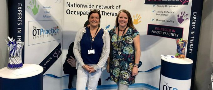 two members of the ot practice stood at their stand
