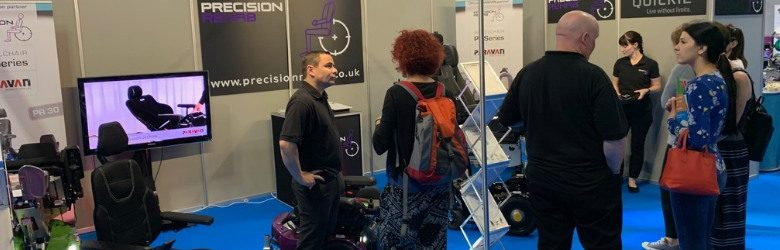 precision rehab reps at their stand