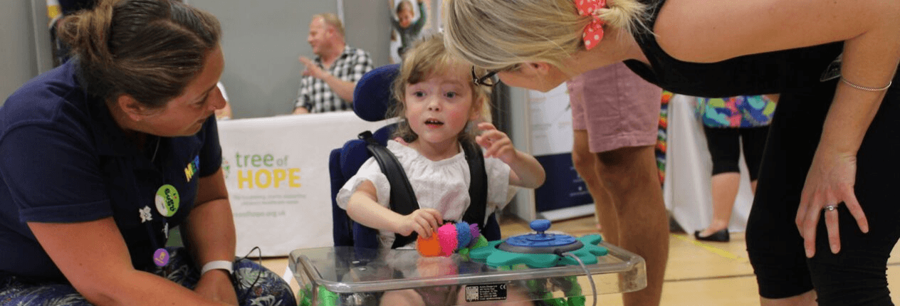 Young girl on wheelchair at the Kidz to Adultz event