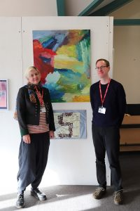 liz and jim stood next to artwork