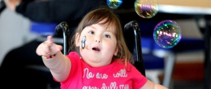 girl in wheelchair with bubbles