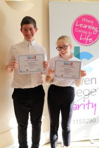 james and isabel holding their certificates