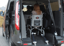 wheelchair user inside mobility vehicle