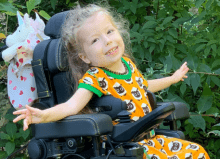 little girl in one of Precision Rehab's Powerchairs
