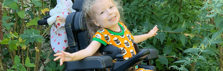 little girl in powerchair