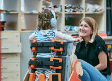 woman smiling and child using Jenx equipment