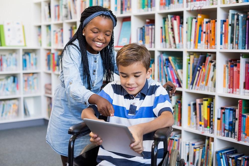 happy school children in library